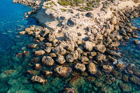 Cyprus coastline aerial top view from drone, Stone Rocks and azure mediterranean sea water in sunny day as beautiful nature resort background.