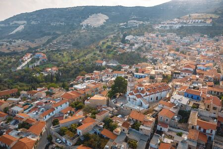 Aerial view of Pano Lefkara village in Larnaca district, Cyprus. Famous old village in mountains with orange roofs.