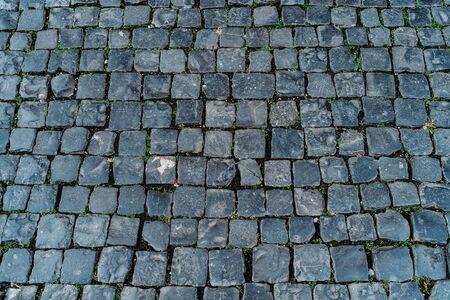 Textura de adoquines, vista superior de la antigua calle Roma como fondo para el diseño.