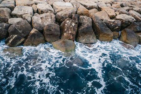 Sea waves and rocky coast in Cyprus. Beautiful nature mediterranean background. Фото со стока