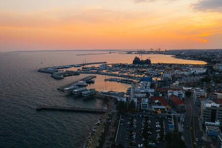 Limassol promenade at sunset, Cyprus. Aerial panoramic view of evening Limassol from above, drone photo. Mediterranean evening landscape, beautiful Cyprus resort for vacation.