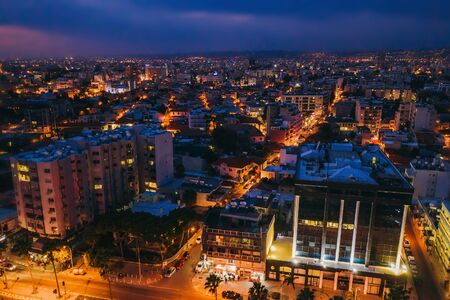 Aerial view of Limassol cityscape, first coastline buildings in Cyprus at night. Drone photo of mediterranean sea resort Limassol from above.