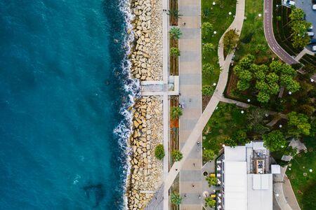 Limassol. Cyprus. Aerial top view of Limassol Molos Park, alley with palms for walking. Mediterranean sea coastline.