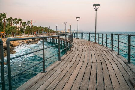 Cyprus. Limassol. Wooden pier on promenade and Mediterranean Sea. Travels to Cyprus concept.