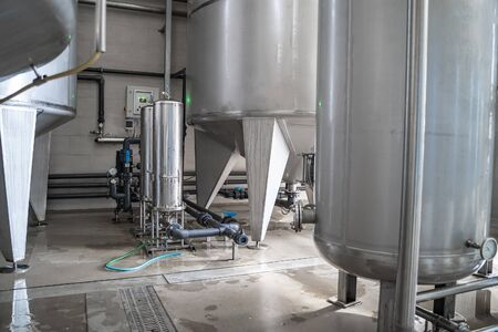 Water plant production or brewery. Large steel tanks for filtering and potable water treatment. Industry background. Stock Photo