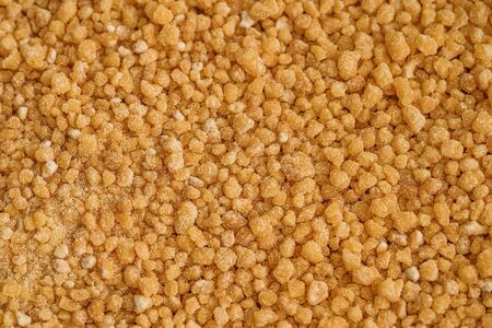 Soya Lecithin Granules background texture, macro photo. Vitamin and dietary supplements. Healthy nutrition concept.