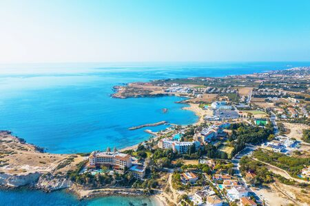 Aerial panoramic view of Cyprus landscape with hotels, bays with beaches and clear mediterranean sea water. Travel to Cyprus concept with copy space.