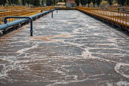 Modern wastewater treatment factory. Water purification tanks. Imagens