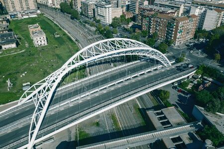 Road bridge over railroad in Rome, Italy, aerial view from drone. Stock Photo