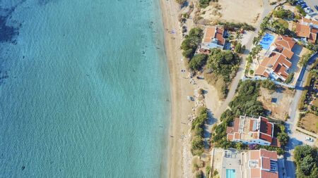 Aerial view of Coral Bay beach - popular beach with clear sea water and comfortable sandy beach in Peyia village, Cyprus.