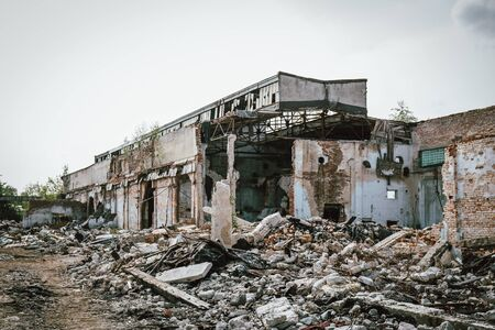 Abandoned, ruined and destroyed building in military conflict area.