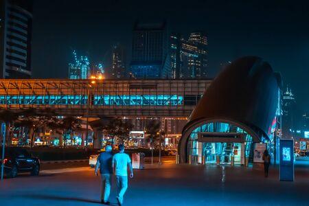 Metro station and Dubai street at night, Dubai United Arab Emirates.
