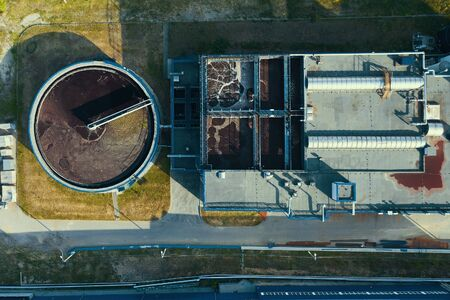 Industrial wastewater cleaning in round storage. Sewage treatment plant, aerial top view. Фото со стока