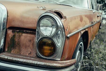 Old rusty grunge retro vintage car with peeling paint close up, abandoned auto. Reklamní fotografie
