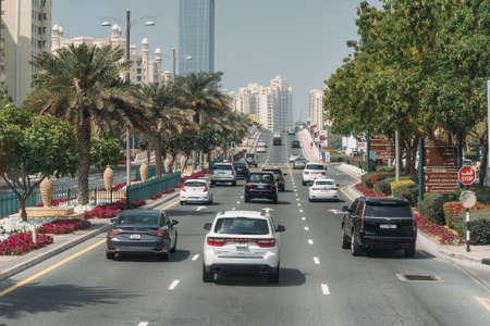 DUBAI, UAE - February 2020: Traffic on Dubai road with many cars. Dubai Marina street.