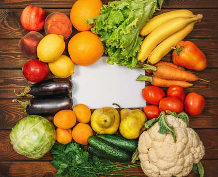 Healthy Organic Food background with Copy Space. Vegan or Vegetarian Food, Raw Vegetables and Fruits on wooden table, Top View.