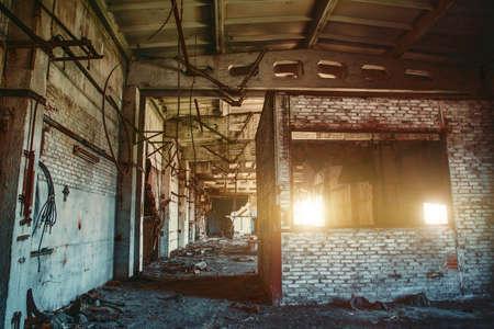 Old abandoned industrial building interior, forgotten room, horror atmosphere.