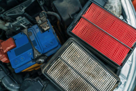 Used dirty Air Filter and New one, timely maintenance and service of your car. 版權商用圖片