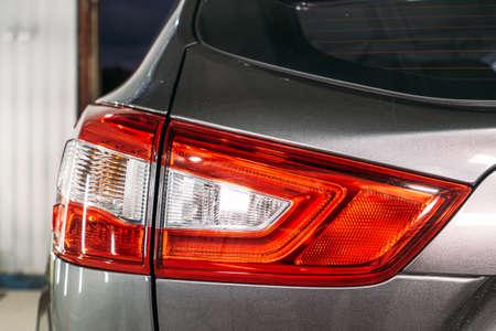 Polished optics of rear lights of car, close up.
