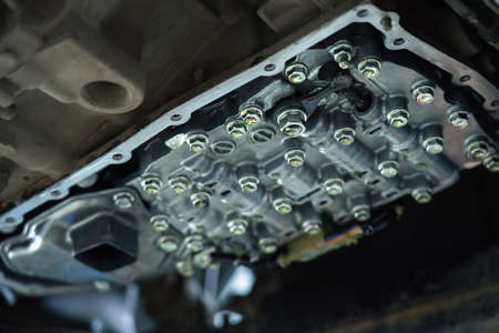 CVT gearbox close up, changing oil in modern automatic transmission on SUV in Car Service. 版權商用圖片