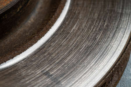 Old used car rotor brake disc, close up.