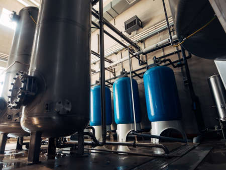 Drinking water factory production, industrial interior. Large metal tanks for filtering and potable water. 版權商用圖片