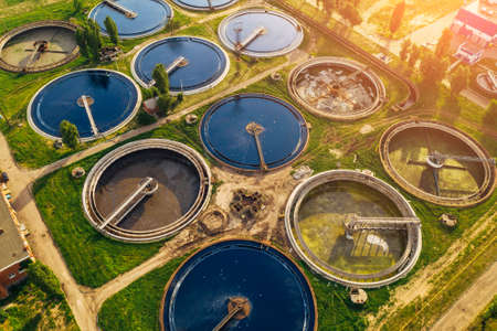 Aerial top view of wastewater treatment plant, filtration of dirty or sewage water.