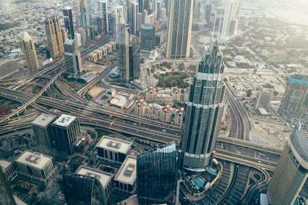 Dubai Skyscrapers and high rise city buildings aerial view in morning, United Arab Emirates.