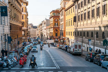 Rome, Italy - 2020: Historical center of Rome, Italy with ancient buildings, tourists on streets and car traffic. Italian travel.