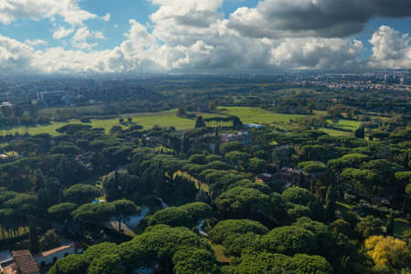 Green park and meadows of Via Appia Antica in Rome, Italy. Aerial view of ancient European nature landscape.