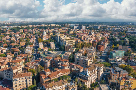 Rome cityscape aerial panorama of many buildings with orange roofs from above. Beautiful Italy city landscape.
