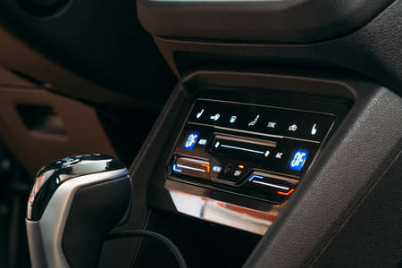 New modern sensor car climate control panel or console of air conditioner, sensor buttons, close up.
