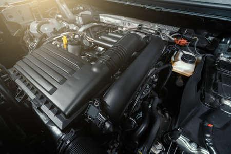 Modern turbocharged eco-friendly engine or motor under vehicle hood close up. Reklamní fotografie