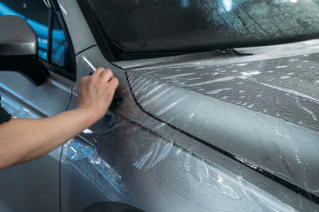 Process of Installing PPF or Paint Protection Film on car. Protective polymer skin for car.