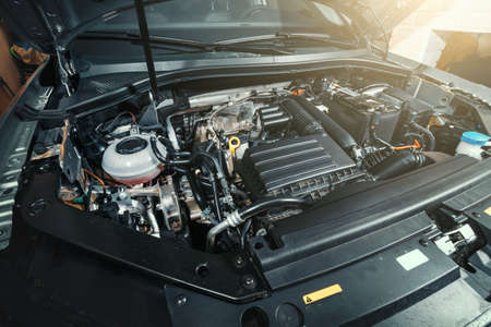View under Car Hood of Modern turbocharged eco-friendly engine or motor.