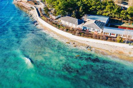 Aerial view at sea coastline with buildings near ocean water, beautiful azure water, summer travel concept. Reklamní fotografie