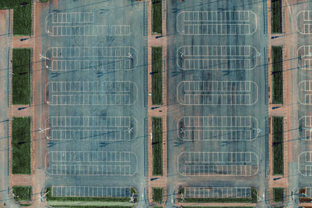 Empty car parking lots aerial top view from drone. Concrete urban background with white lines. Reklamní fotografie