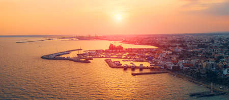 Limassol aerial view, Cyprus, dramatic sunset above yachts and boats port in famous mediterranean city resort, panoramic image or long wide banner with copy space.