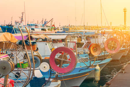 Fishing boats and yachts at sunset in Limassol old port, Cyprus. Mediterranean sea and Greek culture. Reklamní fotografie