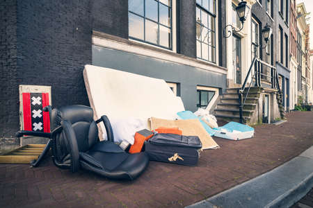 Throwing away unnecessary things that anyone can pick up, old Amsterdam tradition, Netherlands. Imagens