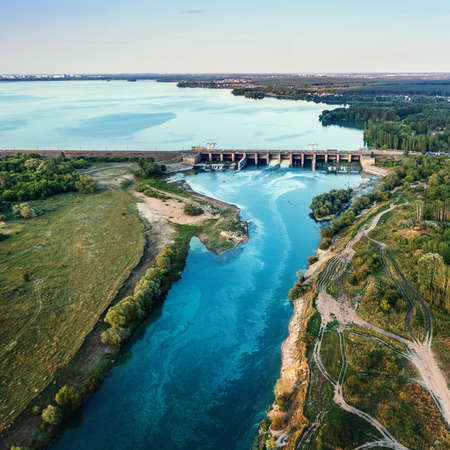 Hydroelectric dam on river with beautiful nature landscape, aerial view.