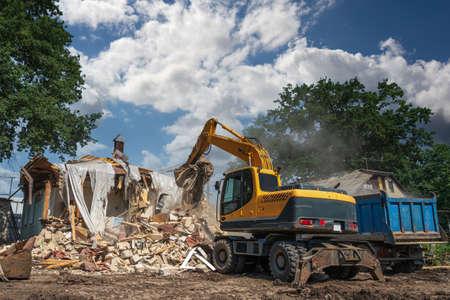 Hydraulic Excavator Breaks House. Building Demolition or Destruction for New Construction. Reklamní fotografie