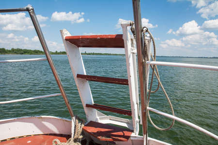 ship bow: bow of the ship on the lake in clear weather Stock Photo