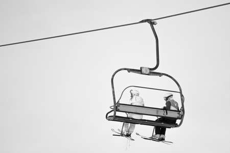skiers on a funicular railway cable car ski resort on the slope of the mountains Banque d'images
