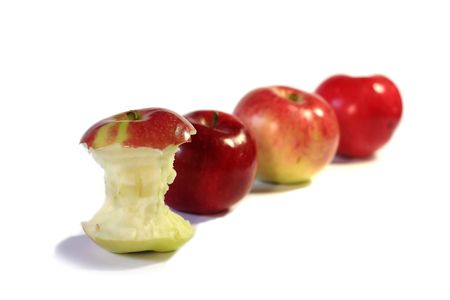 Hitten apple and other apples behind it Stock Photo
