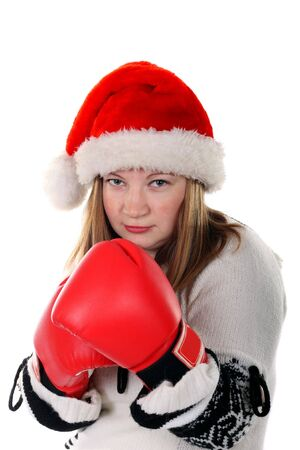 Young women in santas hat with boxing gloves
