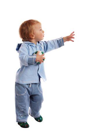 Little boy tenere un pallone da calcio nelle sue mani  Archivio Fotografico
