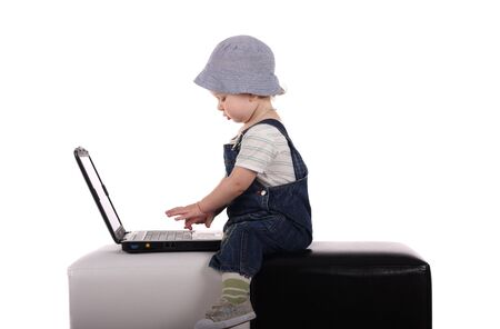 Little boy sitting with a laptop isolated on the white