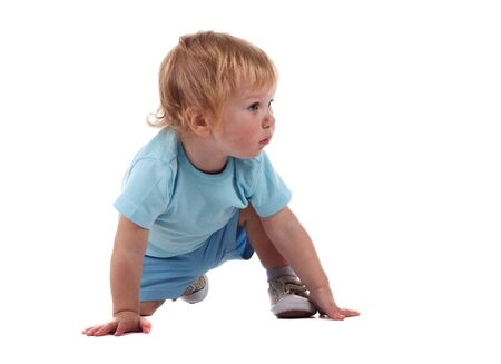 A little boy on all fours isolated on the white Stock Photo