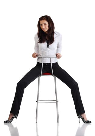 Girl sitting on the bar chair at white background Stock Photo - 6820964